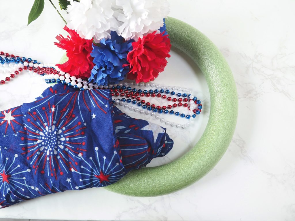 Easy DIY Dollar Store Patriotic Wreath Tutorial - createwithclaudia.com - #fourthofjuly #patriotic