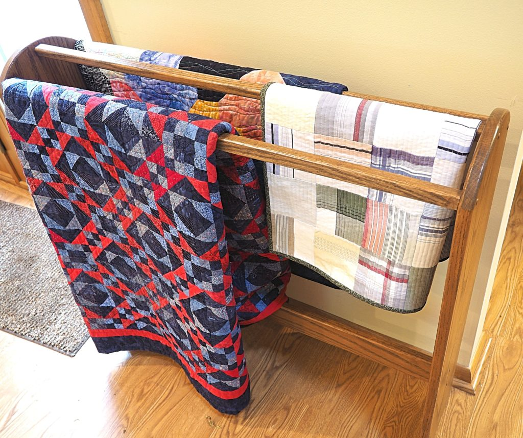 Floor quilt racks are a nice way to show off multiple quilts