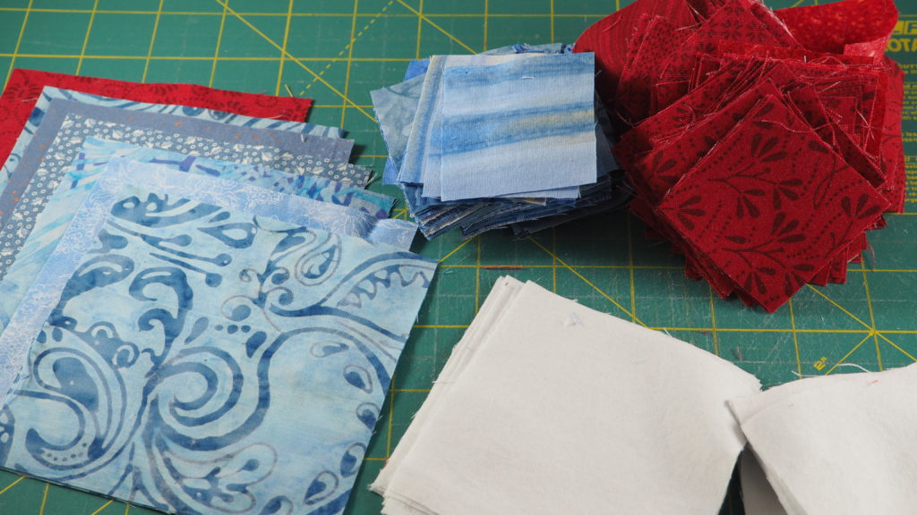Cutting fabric for the scrap busting patriotic table runner.
